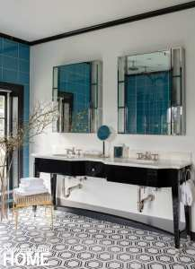 Art Deco inspired bathroom with dark vanity and white and blue tile