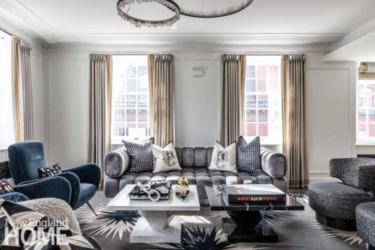 Loya and homeowner Emilia Fazzalari Grousbeck chose furniture that would be comfortable for tall house guests; witness the deep Todd Merrill Studio sofa.