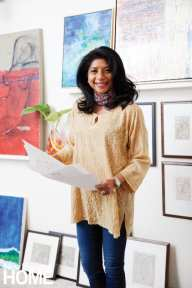Surrounded by her fine art, interior designer and artist Vani Sayeed reviews sketches of design projects, lending her artist's eye to homeowner clients.
