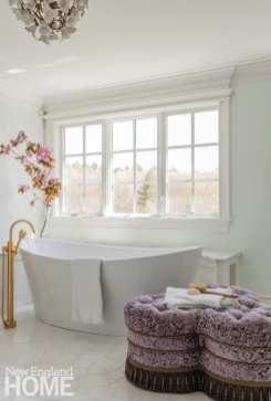 White freestanding tub under a window