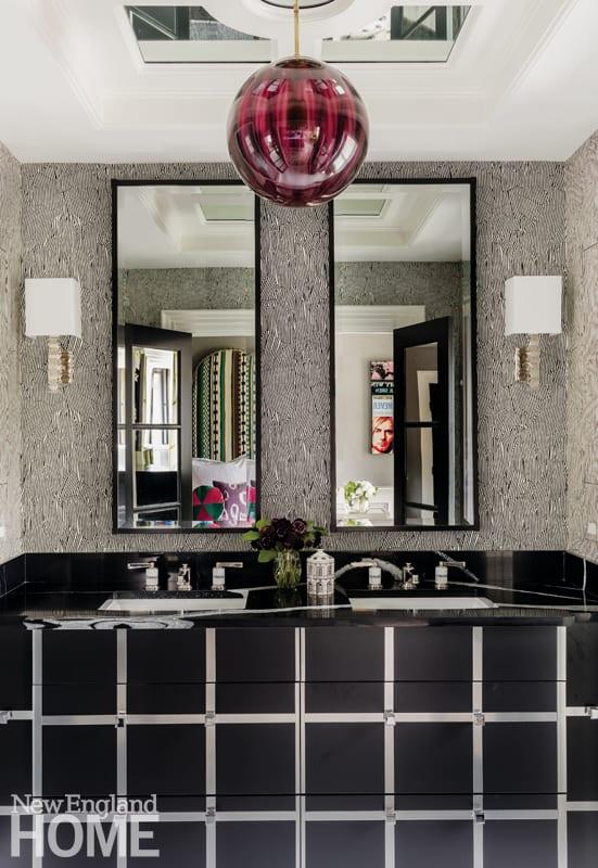 Bathroom featuring black-and-stainless steel vanity designed by Justin Van Breeda