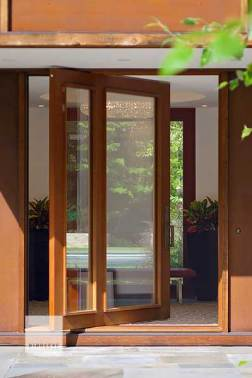 Pivot doors are a great way to make a statement, and they are always a fun challenge for our shop. Pivot systems require holding extremely tight tolerances during fabrication, and ensuring they operate flawlessly and provide the necessary weather protection and security is tricky, but the end result is a door that really stands out. Photo by Jim Westphalen