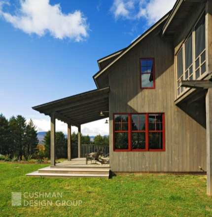 A barn-inspired home with an expansive front porch is designed to take advantage of the mountain views. Photo by Susan Teare.