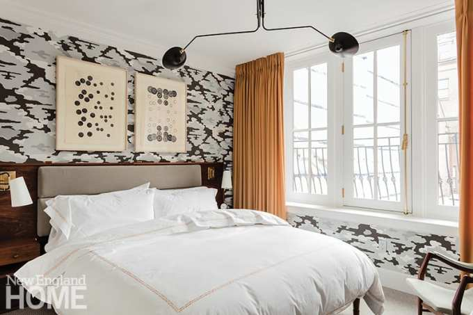 Guest bedroom with a Serge Mouille ceiling light