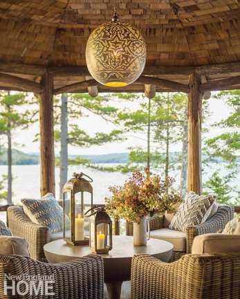 "The porch, furnished with neutral RH wicker seating and a showstopping Moroccan lighting fixture from Tazi Designs, is the favorite daytime gathering place. ""There is plenty of color and drama in the view,"" the designer says."