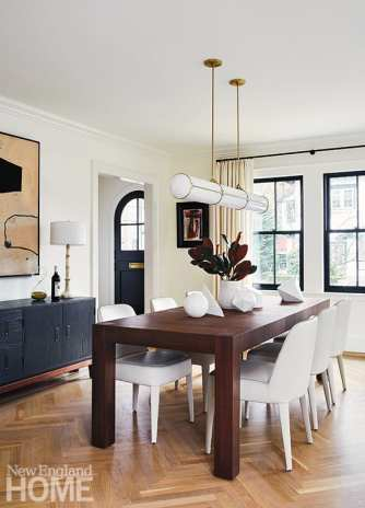 Neutral dining room with contemporary pendant light.