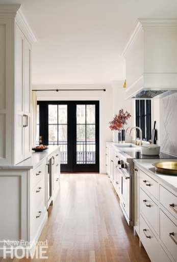 WHite kitchen with black interior windows and door.