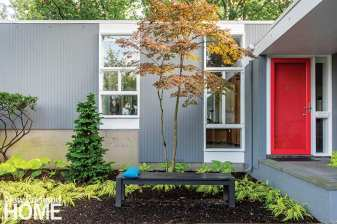 The homeowners decided that the front door needed accenting, so they opted for a shade of lipstick red (Benjamin Moore Red 2000-10).