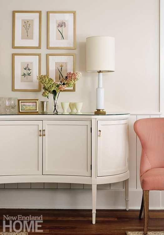 White painted console with pink chair