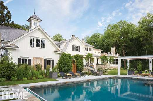 Exterior of large home with pool