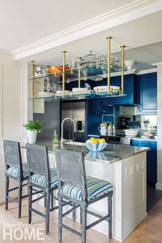 Contemporary kitchen with bold blue cabinetry and floral wallpaper.