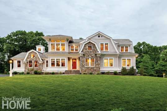Traditional style home in Norwell, Massachusetts with cupola.