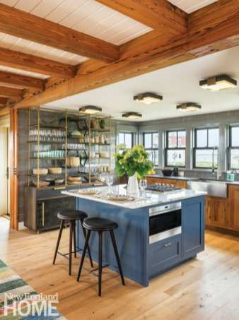 Converted barn kitchen with a blue kitchen island.