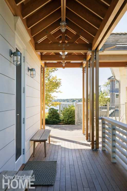 Ships lanterns offer an appropriately nautical touch to an outdoor hallway between the main house and the pool cabana.