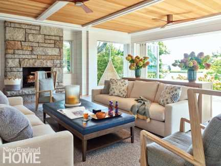 The living room has glass on three sides, so it can be opened to the summer breezes. The TV pops up from the console behind the sofa and can rotate to be watched from indoors or out. Outdoor carpeting and performance fabrics mean wet bathing suits and sandy feet are no problem.