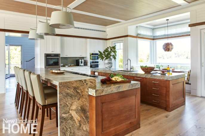 """""""This is not a display kitchen by any stretch,"""" says interior designer Manuel de Santaren about the well-used kitchen. Leathered quartzite countertops stand up to hot pans and sharp knives, while the oak cabinetry's simple profile and clear finish make for easy cleaning. FACING"""