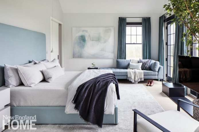 """A cozy reading nook on the second floor is """"an unexpected place to hang out on a rainy day,"""" says architect Andrew Kotchen of one of his favorite spaces in the home. The main bedroom features a serene palette and a Blu Dot daybed."""