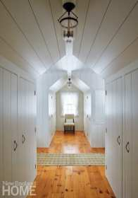 Hallway of Maine cottage with white walls