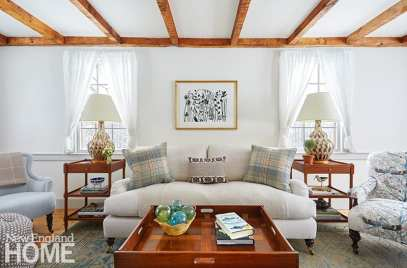 Neutral living room with rustic wood beams