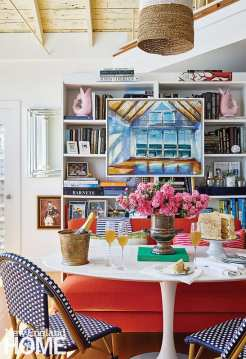A commissioned painting of the living room by regional artist Adam O'Day helps drive the tone and hues for the interior styling.