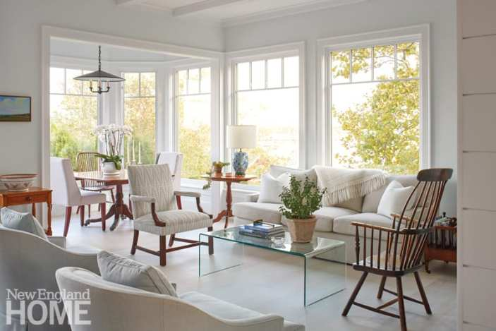Living room with white upholstered pieces and dark wood furniture.
