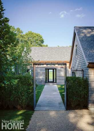 Alongside the garage, the first of three aediculae, or frames, greets visitors on a path that extends through the house to end at a window trained on a distant shore. The purpose is to emphasize each transition, says architect Thomas McNeill.