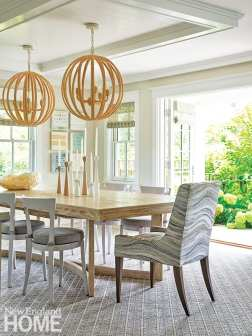 Dining area with two large jute pendants