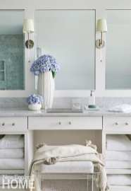 White bathroom with marble-topped vanity.