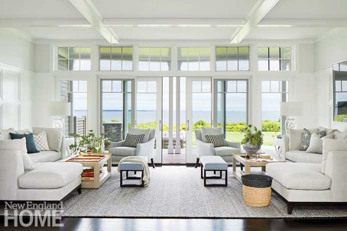 Living room with floor to ceiling windows and a coastal view.