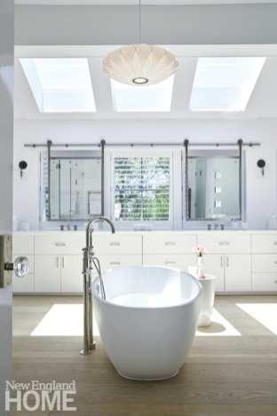 The mirrors in the en suite bathroom slide on tracks to regulate light exposure.