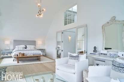The airy and tranquil main bedroom offers the homeowners views of Long Island Sound from a pair of Formations swivel chairs.