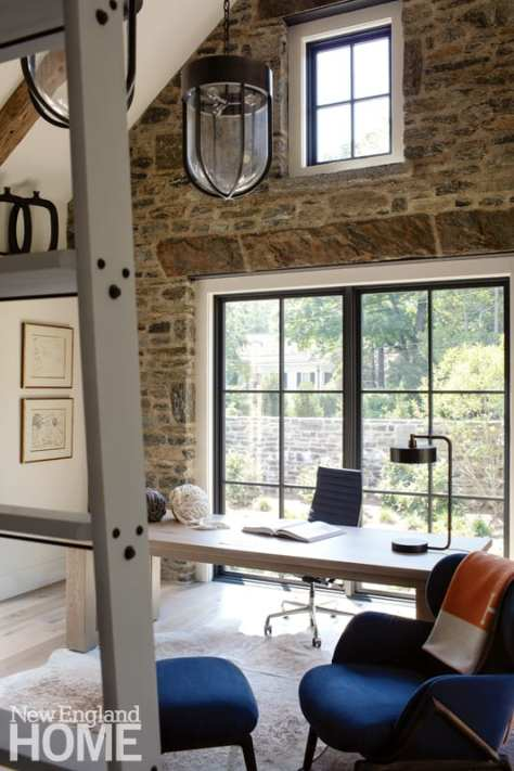 On the other side of the courtyard, a library ladder provides access to tall bookshelves in the owner's home office.