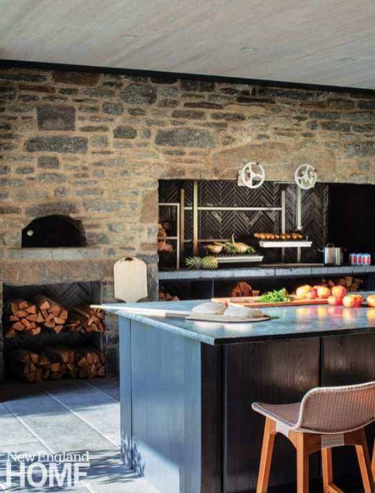 A pizza oven and wood-fired barbecue grill, or parrilla, fulfill every dining request from the outdoor kitchen.