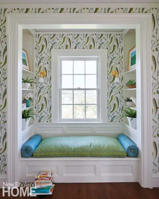 A cleverly designed nook sits in a corridor between two of the daughters' bedrooms. The colors in the Cowtan & Tout wallpaper and Carolina Irving Textiles seat cushion reflect the landscape outside.