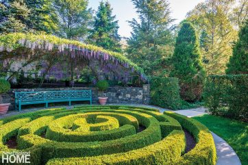 When the wisteria sends down its shower of fragrant purple blossoms, Landman favors the curved bench custom designed by Stick. Resting in the shade of the stainless-steel arbor, he can contemplate the view across the boxwood maze to a distant fountain.
