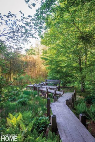The zigzag bridge in the garden's Spirit Walk hovers above a glade of irises and ferns; the irregular pathway is meant to avoid evil spirits, which reputedly only travel in a straight line.