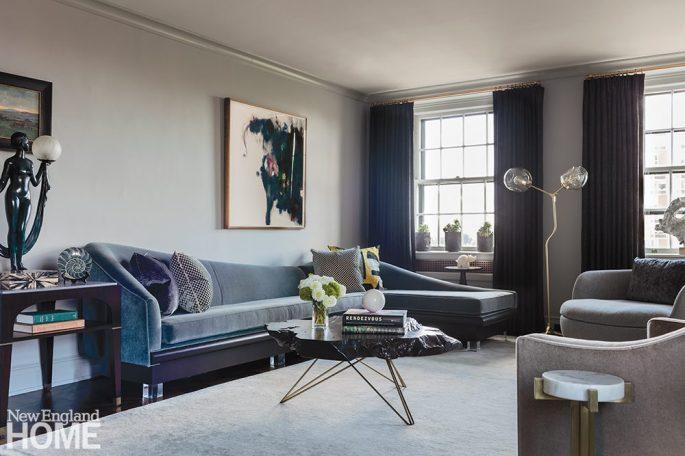 Gray family room with large gray velvet sofa.