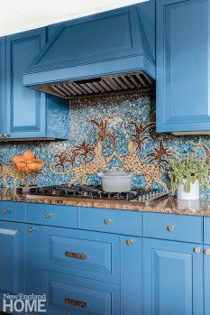 Bright blue kitchen with leopard tiled back splash.