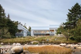 Contemporary coastal Maine home view from water.