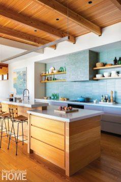 Contemporary kitchen with blue Heath Ceramics backsplash.