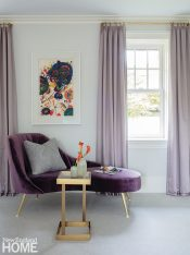 A small settee and a drink table in the bedroom set the scene for relaxation.