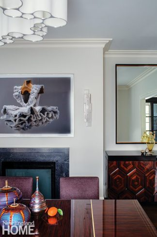 Dining room featuring a painting by Sigalit Landau.