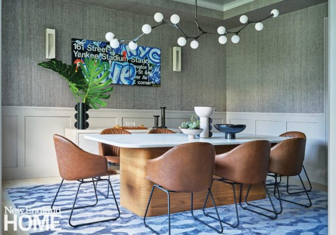 Dining area with leather seats and a marble table.