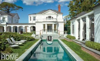 The exterior of the library/nymphaeum recently completed on the grounds of Newport, Rhode Island's Bellevue House features such Federal-era details as the demilune and bay windows and the ornamented pediment. The lap pool leads toward the library, and there are cabanas on the right.