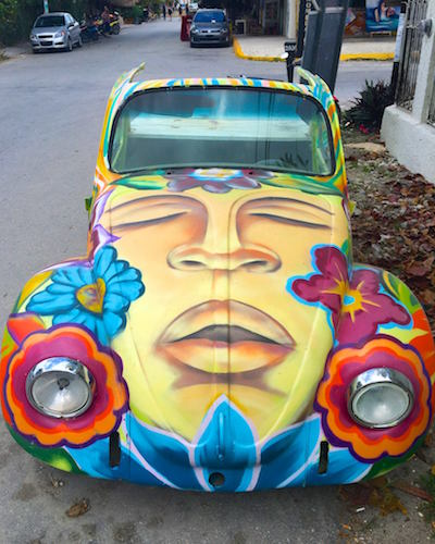 car with colorful painted face