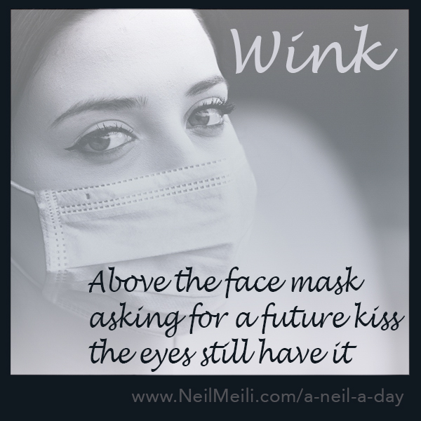 Above the face mask asking for a future kiss the eyes still have it