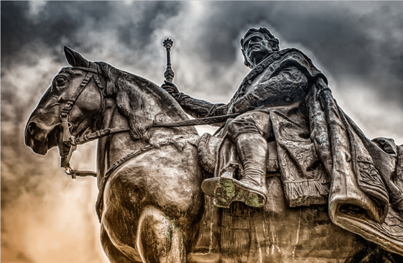 statue of man riding on a horse