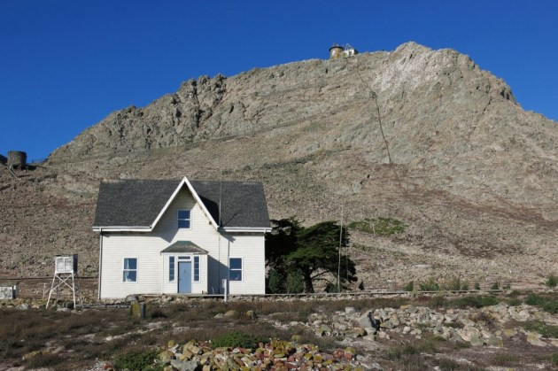 Figure 4. Home sweet home. One of the two former lighthouse keeper's houses, they were originally constructed in the 1800s. In the background is Lighthouse Hill, with a peak elevation of approximately 360'.