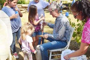 New Albany MS Heritage Pioneer Days 2019, churning butter