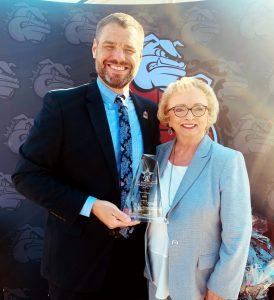 Dr. Wright presents award